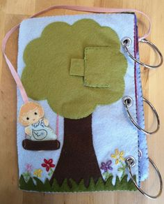 Cute tree page, with dolly on ribbon that can play on the swing, and a peekaboo pocket with a bird inside