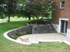 sunk in patio basement stairs with retaining wall pavers Walkout Basement Patio, Basement Window Well, Basement Entrance, Basement Stairs, Retaining Wall Patio, Landscaping Retaining Walls, Patio Wall, Landscaping Ideas, Backyard Landscaping
