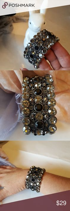 Bracelet lia sophia Bracelet lia sophia. 5 rows of smoke and black crystals inset in a filigree style medal bracele, like new, elastic too. Was boxed and sealed as most of my pieces are. unused. Lia Sophia Jewelry Bracelets