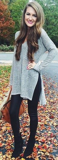 Grey + Black long sleeve split side fall shirt with black pants                                                                             Source