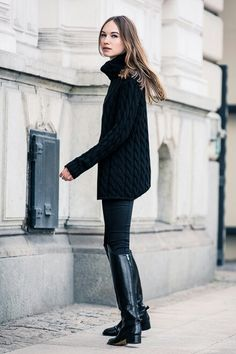 Black oversize turtleneck sweater, skinny black pants/leggings, knee high black riding boots with low heel