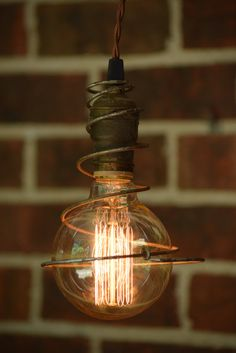 These custom pendant lights add just a touch of whimsy to any space. These vintage springs have a nice industrial looking rusty finish. Each light