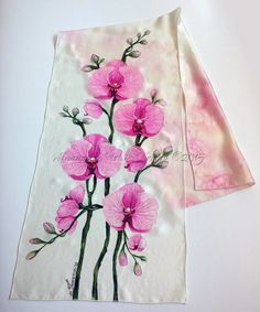 Hi! This is 100% pure silk and hand painted one-of-a-kind piece of wearable art. Well orchids are one of my favourite flowers ! I just love to paint them and always challenge myself with different techniques. This scarf is with elegant and simple design of orchid branch painted to look like aquarelle painting on one side and on the other side for balance of the design - more delicate overflowing pink and vanilla colors with effect which can be achieved only on silk. For the orchids I have…