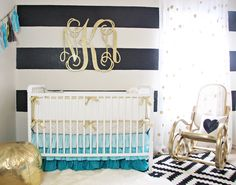 Gold Nursery Design - we love the turquoise accents, and can't stop drooling over the bent wood gold rocker and that gorgeous crib bedding. Heart. Stop.