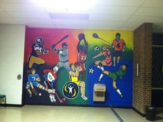 Sports mural painted by WWRC students in the Watson Recreation Center