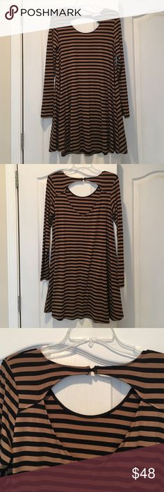 Dress NWOT ❗️firm❗️ Brown and black striped long sleeve dress. Scoop neck and back has an opening. Altar'd State Dresses