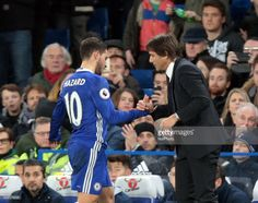Chelsea manager Antonio Conte shanks hands with Chelsea's Eden Hazard during the EPL Premier League match between Chelsea and Tottenham Hotspur at Stamford Bridge, London, England on 26 November 2016.