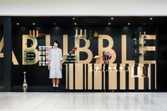 PapaBubble - shop design by Torafu Architects, Japan 10m2 shop on a train platform, the architects say they planned the whole store as one big signboard, turning the lack of depth from a problem to a focal point