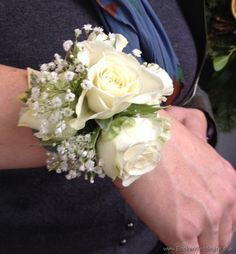 Ivory Rose and Gypsophila Wrist Corsage on a bracelet - great for wedding flowers for people who don't want to pin to their outfits or Prom flowers | Booker Flowers and Gifts, Liverpool | Wedding Florist Specialists Liverpool