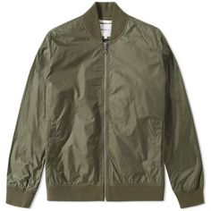 Norse Projects Ryan Light Ripstop Bomber Jacket ($260) ❤ liked on Polyvore featuring men's fashion, men's clothing, men's outerwear, men's jackets, mens lightweight jacket, mens military style jacket, mens bomber jacket, mens zip up jacket and mens vintage jacket