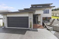 Marius Stanis - Lodge Real Estate Hamilton, New Zealand: For Sale by Auction - 9 WESTVIEW PLACE, WESTERN HE... Heat Pump, Living Area, Hamilton, Westerns, Brick, Garage Doors, Auction, Real Estate, Exterior