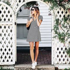 a black and white striped wrap mini dress with short sleeves and white sneakers for a comfy casual outfit