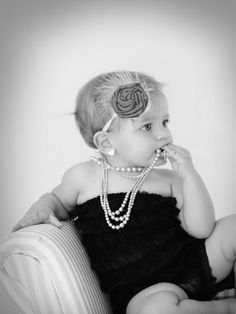 this is precious - if i am lucky enough to have a baby girl, she will be in pearls and flowers and ruffles and bling :)