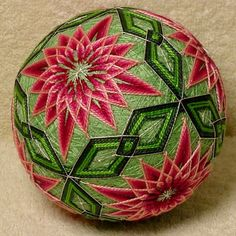 Temari is an ancient form of Japanese culture and art, the gift or a Temari ball is believed to bring good fortune to the recipient. This Temari ball is a Styrofoam balls wrapped with yarn and thread and sewn with contemporary and traditional patterns. This ball is made by me, Beth