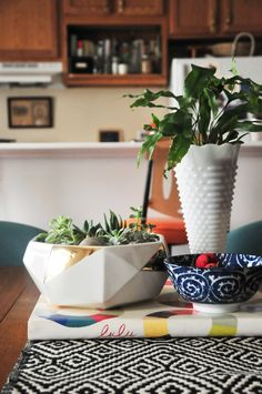 Your dining room table is another opportunity to enjoy your favorite books, fabrics, bowls and plants.  --LYC