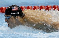 United States' Michael Phelps swims in the men's 4 X 100-meter medley relay at the Aquatics Centre in the Olympic Park during the 2012 Summer Olympics in London, Saturday, Aug. 4, 2012. (AP Photo/Michael Sohn); the greatest Olympian EVER!!!!