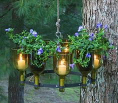 made with recycled wine bottle - chandelier with candles, flowers, & herbs