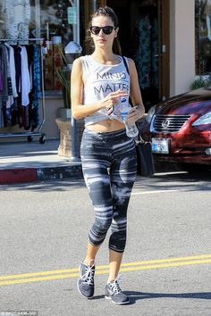 Working hard: Alessandra Ambrosio was spotted coming out of yet another gym session ahead ...