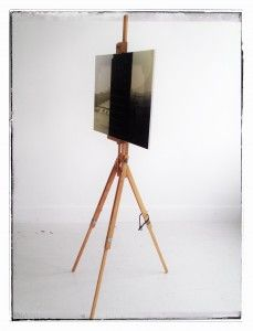 Wooden easel with some paint splatter from the previous artist