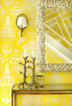 Sunshine. Palm Beach chic. Love the shell mirror, too.