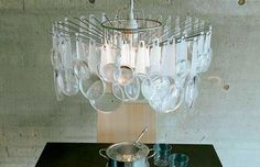 Magnifying glass chandelier by Habitat.