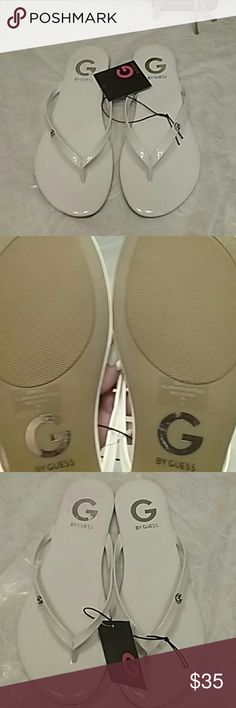 NEW Guess Sandles Brand new tags still attached white and silver Guess sandals shown in photo 3 from the sticker on the right sandal a little bit of the G is messed up Guess Shoes Sandals