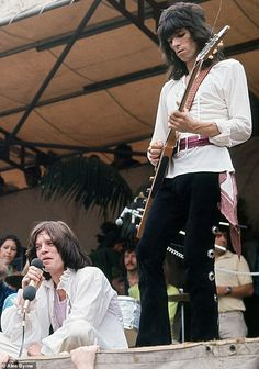 The Rolling Stones singer Mick Jagger, photographed by Alec Byrne, sits on stage as guitarist Keith Richards performs next to him at their free concert in London's Hyde Park in July 1969 Smooth Jazz, Rock And Roll Bands, Rock Roll, Concerts In London, Los Rolling Stones, Rollin Stones, Charlie Watts, Top Trumps, King Richard