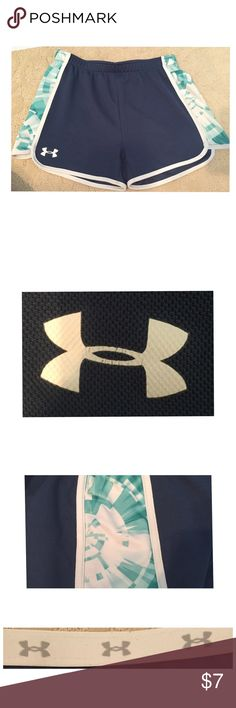 Under Armour Shorts! Size Girls XL Under Armour Shorts For Sale! These are Navy Blue with a Turquoise/White Design on the side. When you flip over the band it has the repeated Under Armour Logo! These fit like a women's XS as a reference!GUC! The Under Armour Logo has cracked slightly but nothing you can notice! Smoke free home! Under Armour Shorts