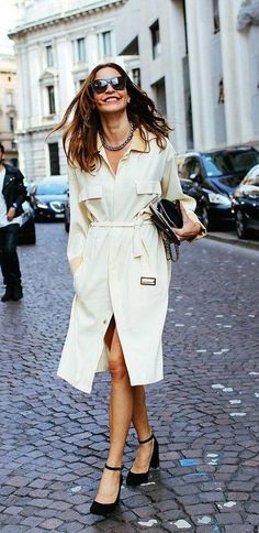 Ece Sukan in a cream silk Umit Benan belted coat
