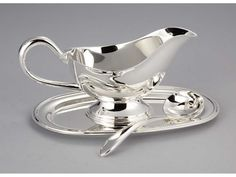 Sculpta Silver Plated Gravy Boat with Tray and Spoon  http://www.thebowlcompany.com/products/Sculpta-Silver-Plated-Gravy-Boat-with-Tray-and-Spoon/162076