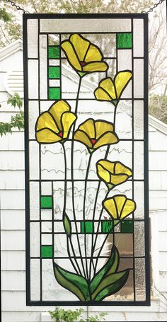 Yellow Poppies Geometric Custom--One panel 10 x 23 5/16 This listing is for a newly completed stained glass panel design of Yellow Poppies over Geometric. The panel measures 10 x 23 5/16. It has different types of clear textured glass, and bright yellow as well as bright green glass. I made two panels that were symmetrical. You could choose either orientation. It has a black patina on the lead and frame so as to bring out the striking colors of the glass. The panel will be signed and…