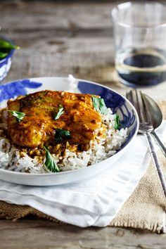 Fresh hake in a creamy, lightly curried sauce, baked until just cooked through, served with spiced rice and blanched sugar snap peas.