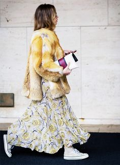 Another way to wear a more summery dress is by topping it with a faux-fur coat. Feel like the furry jacket is too much? Dress it down with a classic sneaker.
