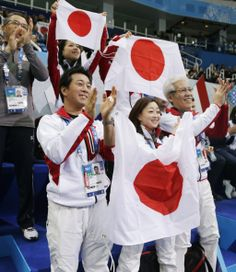 The Japan team cheer for Cathy Reed and Chris Reed of Japan as they compete in the team ice dance short dance figure skating competition at ...