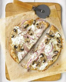 """Thinnest Crust Pizza with Ricotta and Mushrooms:  """"Asiago cheese is full flavored, so a little gives lots of taste. A sandwich wrap instead of pizza dough, when baked, gives you crunch without as many calories -- there are only 305 per serving!    Read more at Marthastewart.com: Thinnest Crust Pizza with Ricotta and Mushrooms - Martha Stewart Recipes"""""""
