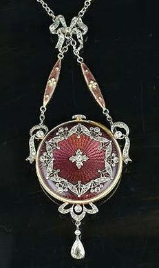 A Belle Époque guilloché enamel and diamond fob watch and chain, the circular dial with Arabic numerals, decorated to the reverse with purple guilloché enamel overlaid with rose-cut diamond stylised foliate motifs, with a pear-shaped diamond swing-drop below, suspended from a chain composed of navette-shaped purple and white guilloché enamel links, with a millegrain-set rose-cut diamond bow spacer. #Edwardian #FobWatch