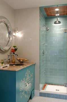 bathroom with turquoise shower and vanity