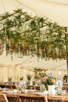 Hanging floral display within our Traditional Tent by Mathew Oliver http://www.matthewoliver.co.uk/