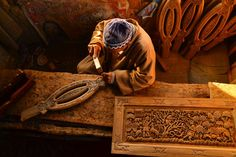 Wood carving. Photo by basit ali - Carved walnut wood-work is among the most important crafts of Kashmir, India, now one of the few places in the world where walnut is still available at an altitude of 5500-7500 feet above see level. The wood is hard and durable, its close grain and even texture facilitating fine and detailed work. unfortunately this art is dying a slow death as the younger generation does not have the patience to master the skills which take years and years of practice