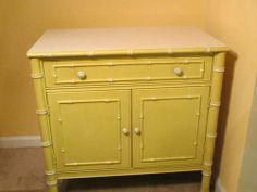 Thomasville Faux Bamboo Table $125 - This could be a great pop of color in a room, maybe as a bedside table.