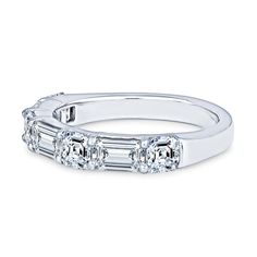 This exquisite JB Star ring has a 2.47ct total diamond weight, set in a platinum wedding band. Three of those diamonds are emerald cut, with a total weight of 1.25ct and the other four diamonds are asscher cut, at 1.22ct total weight. The ring Asscher Cut Diamond, Diamond Cuts, Platinum Diamond Wedding Band, Weight Set, Star Ring, Stone Cuts, Diamond Stone, Wedding Bands, Romantic Fashion