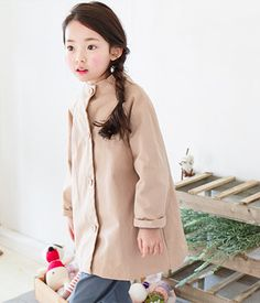 TheJany Button-Down CoatEmbrace your child with warmth when you make her wear this coat that comes with round neckline, back ribbon, long sleeves and button-down closure. Finish her look with sleeved top and jeans.- Round neckline- Long sleeves- Mid-thigh hemline- Button-down closure- Back ribbon accent
