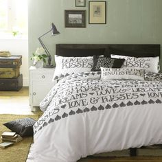 Black Toast Bedding - Black Toast is a decorative typographic design, with another of Matthew's hand-drawn Toast messages proclaiming simply Love & Kisses, and a lovely heart pattern on the reverse printed on soft cotton sateen. #EmmaBridgewater #Bedding