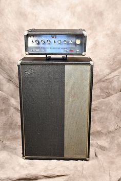 Guild 1970 ThunderBass Amplifier This Bass Enclosure and 50 watt Amplifier in original Black Tolex in a clean as well an unbelievable condition. Bass Amps, Drip Painting, Bass Guitars, Vacuum Tube, Vintage Guitars, My Collection, Thunder, Hold On