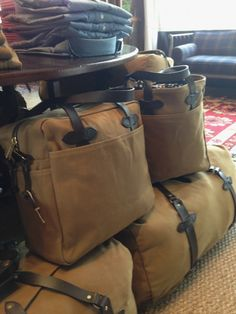 Filson luggage is made with a rugged twill that is designed to last a lifetime. Their tote bags, luggage, and briefcases look polished and rugged all at the same time. Available at Sid Mashburn in a range of colors