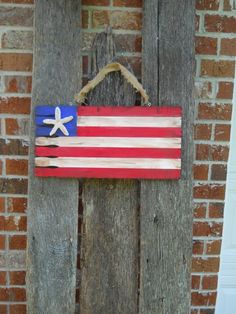 DIY:  How to Make a Wooden Flag with Paint Sticks - 7 paint sticks, craft paint & a starfish or clay.  Great project for the kids!  Via Dreaming-n-color