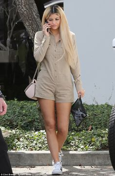 Casual cool: The 18-year-old reality star looked stylish in a beige romper featuring buttons down the middle and pockets on the chest