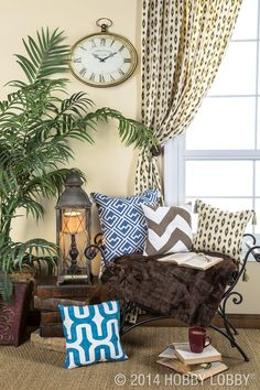 """How do you turn a stuffy space into a place you want to live in? You can start with accent pillows that say, """"Sit down and hang out."""" We went absolutely unfussy for our look—simple styles and durable (but chic) duck cloth in a variety of modern prints. And now, people, we're living in vogue."""