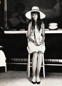 A wide-brimmed felt hat by Halston is worn by Penelope Tree. Her white linen sashed dress designed by Stan Herman sold for $45. LOOK magazine 1968.