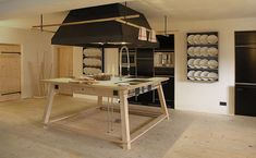 this kitchen reminds me of a modernist interpretation of the old castle kitchens in europe.  berge in Aschau im Chiemgau, Bavaria, Germany.  Managed by Nils Holger, a furniture designer